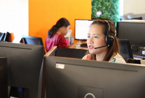 A female customer service agent with a headset
