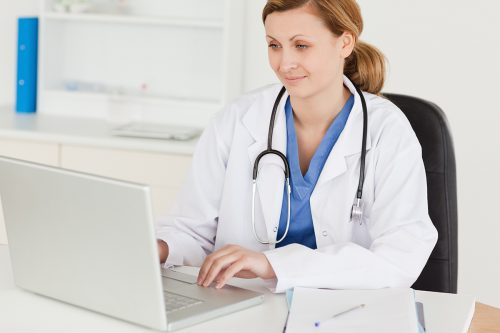 Woman in a White Coat and Stethoscope overseeing Medical Transcriptions