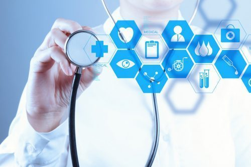 A doctor with a stethoscope with blue icons of outsourced healthcare services