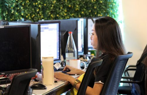 Female Social Media Marketing Employee in front of a Computer