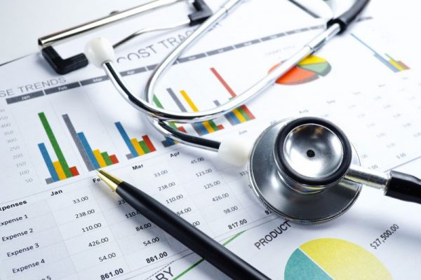 medical billing statement, stethoscope and paper