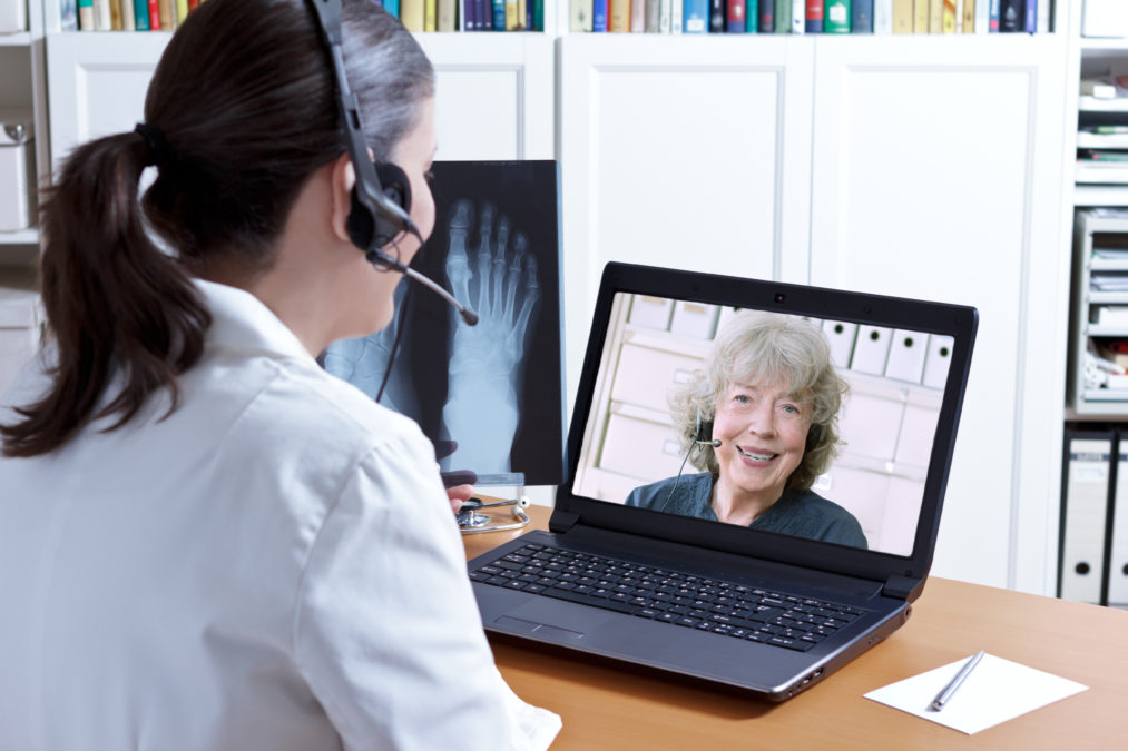 telehealth medical practitioner speaking with a patient in a laptop