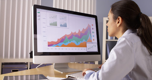 female outsource bookkeeper working with charts