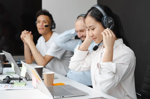 3 outsourcing employees working in a bpo company